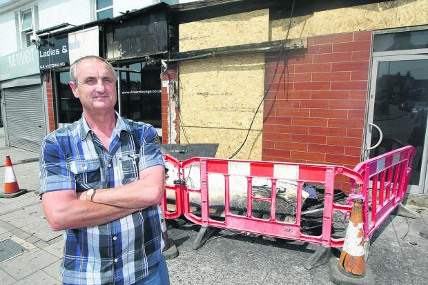 Peter Rogers, the owner of the Dream Lounge in Victoria Road, surveys the damage to the club after the fire