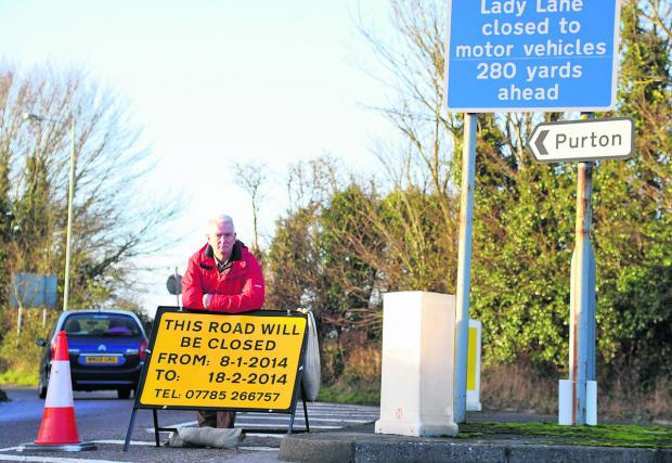 Blunsdon Parish Council chairman Ian Jankinson in Tadpole Lane, which is being closed to allow construction traffic through to build a new school