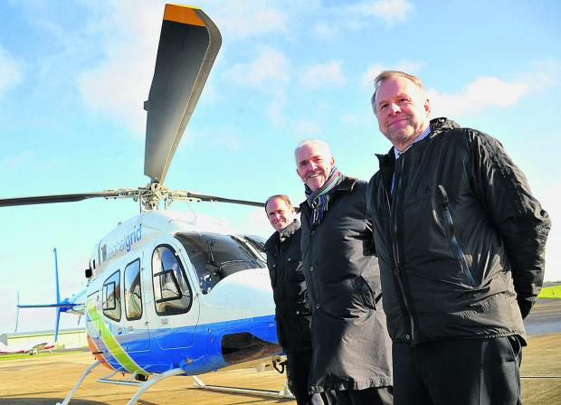 Swindon Advertiser: Bell regional sales manager Rob Pennell, Heli Charter chief executive Ken Wills and Wiltshire Air Ambulance Charitable Trust chairman Chris Lear with the helicopter