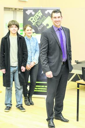 Lee McQueen, the former winner of The Apprentice, speaking to students at Swindon College. From left, James East, Lee McQueen and  Leah Toomey
