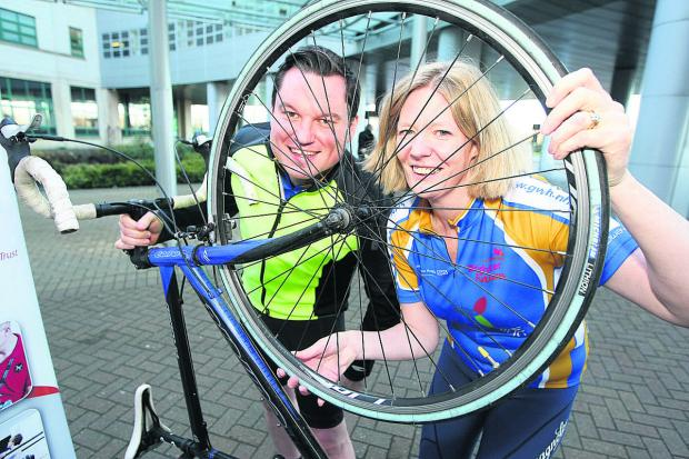 Great Western Hospital director of strategy Kevin McNamara and director of worrkfoce and education Oonagh Fitzgerald who are taking part in the three cities' cycling challenge to raise money