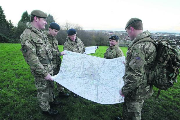Defence Academy students from Shrivenham in Lawn woods, during a planning exercise. From left, Jamie Metcalfe-Tarren, Rich Carter, Phil Herbert, Annabel Felton and Jamie Allan
