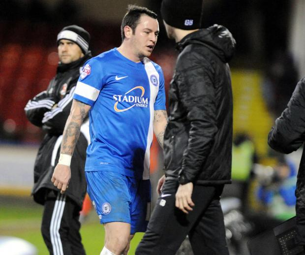 Lee Tomlin was sent off late on in Peterbprough's 2-1 defeat to Swindon Town on Saturday