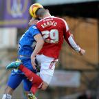 Swindon Advertiser: Raphael Rossi Branco wins a header during his star performance in Swindon Town's victory over Peterborough