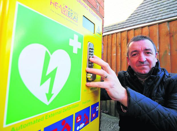 Wanborough Parish Council chairman Gary Sumner with the last of three defibrilators which can be used by the public in emergencies