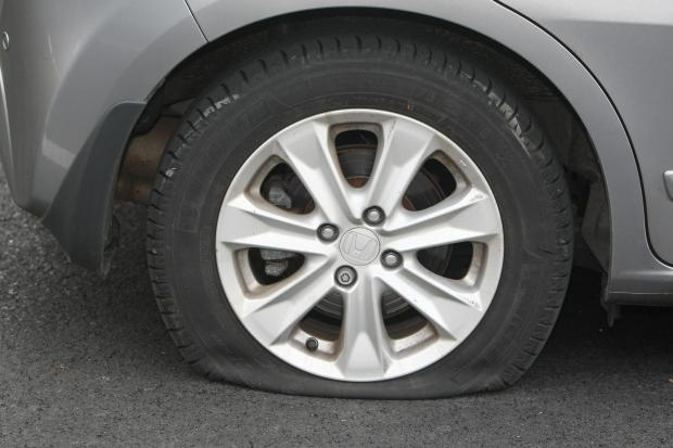 A slashed tyre in Old Town