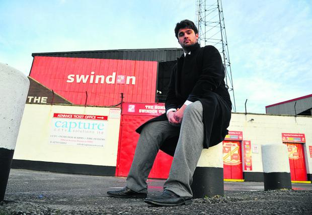 Sam Morshead waits outside the ground for Swindon Town fans before their trip to Stevenage