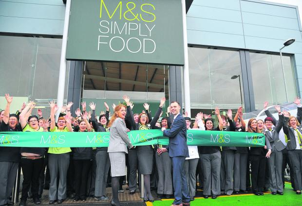 The opening of Marks & Spencer's Simply Food store at Mannington. Regional manager Sarah McCulloch and store manager Chris Hughes perform the duty with delighted staff