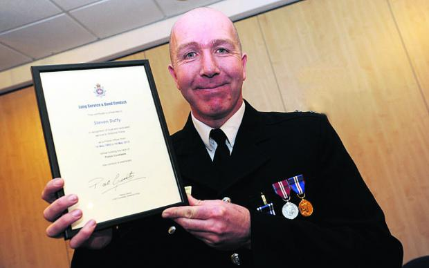 Steve Duffy with his Long Service and Good Conduct Award