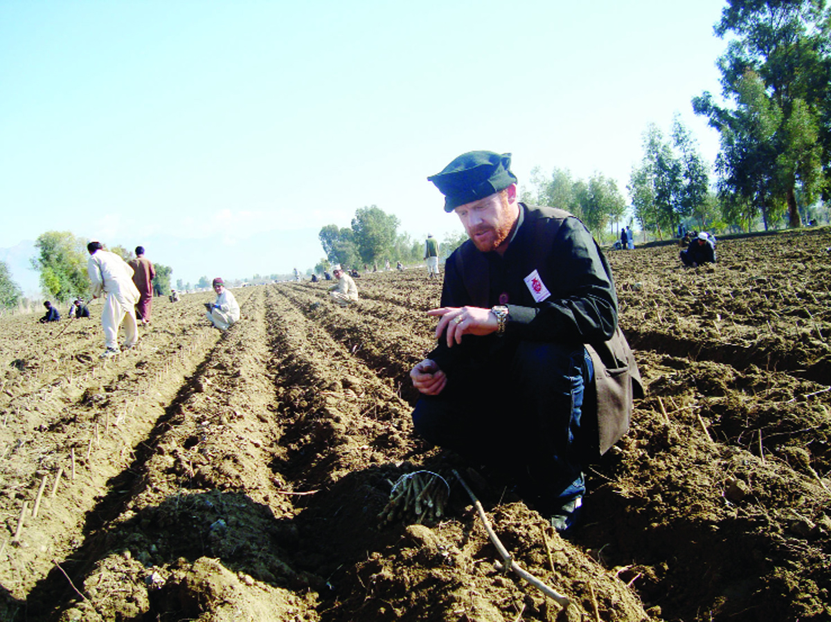 James Brett planting pomegranates in Afghanistan