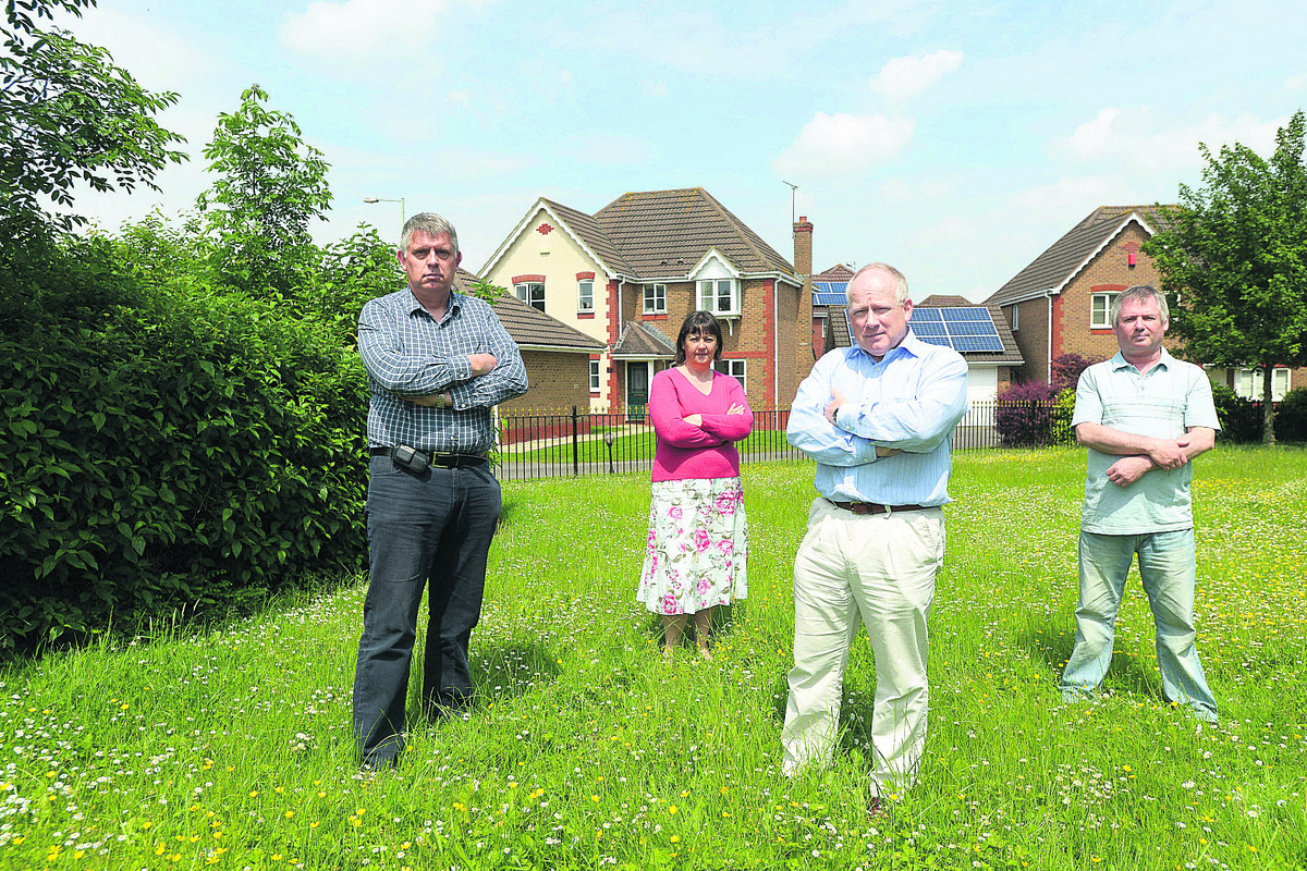 Residents are complaining about Thames Water's plans to build two sewage tanks on Queen Elizabeth Drive. Pictured are Andrew Hargreaves, Linda Hayes, Brian McLean and Roland Hayes