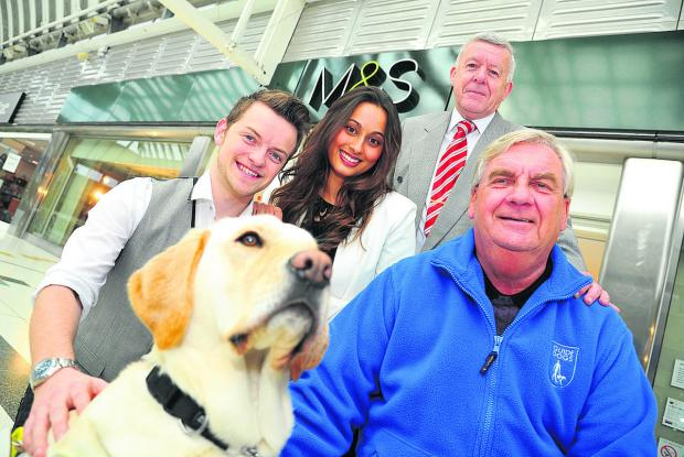 M&S are presenting a cheque for nearly £3,000 to Guide Dogs for the Blind. The money wasraised by store assistant Jack Townsend singing to shoppers over the Christmas period. Left to right, Jack Townsend, Nadina Gedge of M&S, Kevin Reynolds, treasurer Gu
