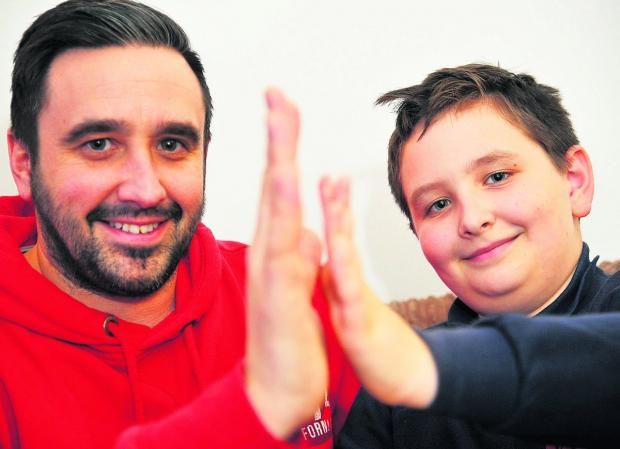 Mark Shannon, pictured with his son Edan, 11, who  signed up to the MEND health programme run by the council and lost half a stone 	        Picture: DAVE COX