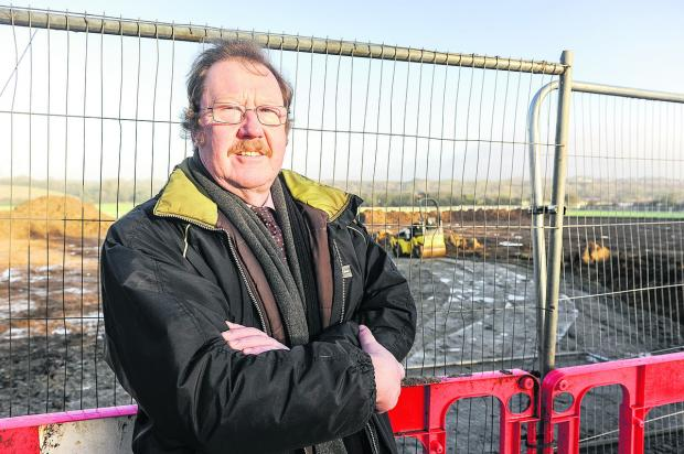 Richard Symonds outside the Ridgeway Farm development, which he is against