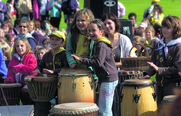 Brownies from North and South Wiltshire districts taking part in a drumming and rhythm workshop at Longleat