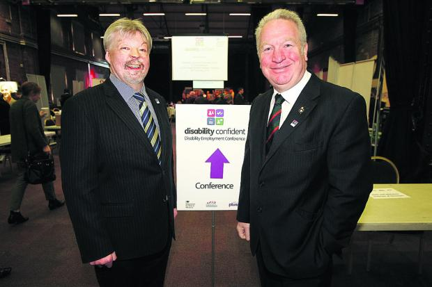Minister of State for disabled people Mike Penning and Falklands veteran Simon Weston at the conference