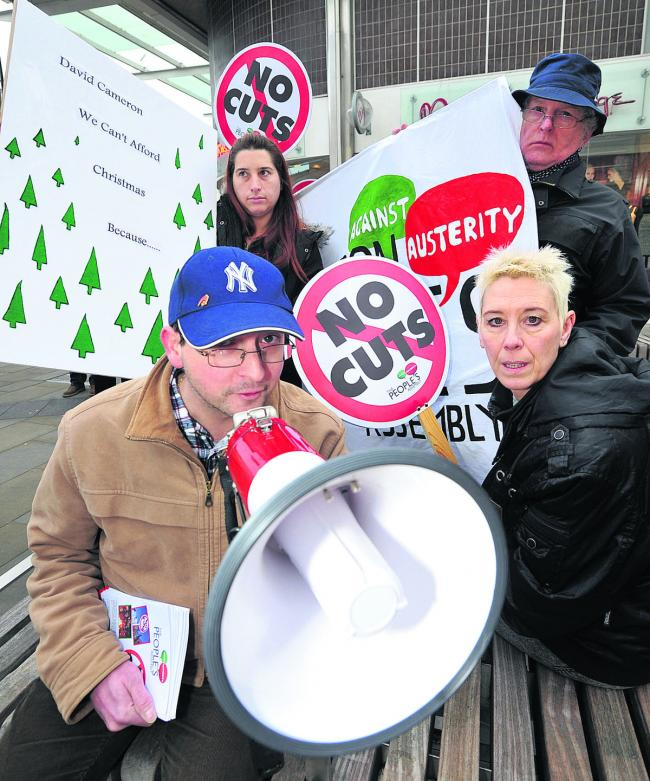 Anti-Austerity protesters in Swindon town centre in December – Karl North, Angel Grace, Liam Sinclair and protest organiser Kate Linnegars