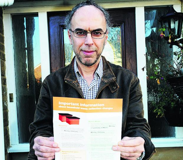 Ahmad Sadjadian with his green waste and the flyer sent out by Swindon Council