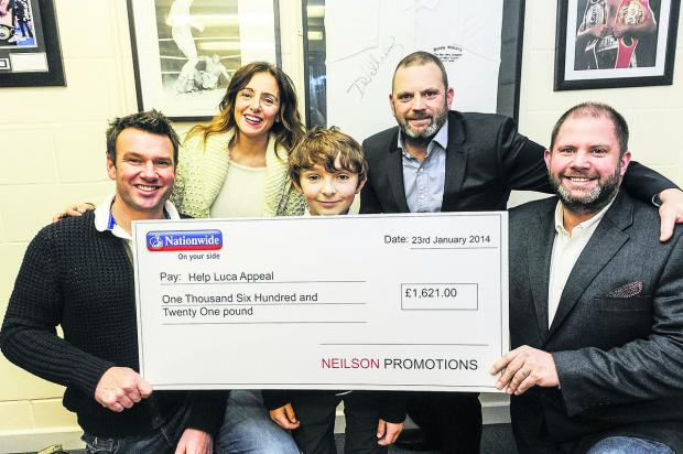 Neilson Promotions presenting a cheque for £1,621 to Luca Railton towards his operation. From left, Alex Railton, Teresa Railton, Luca Railton, Mark Neilson and Tony Neilson