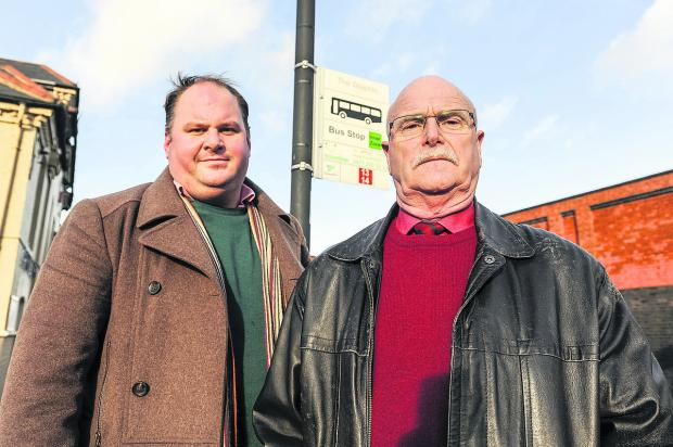 From left, Coun Jim Robbins, and Coun Peter Watts at the number 13/14 bus stop in Rodbourne Road by the Dolphin Pub