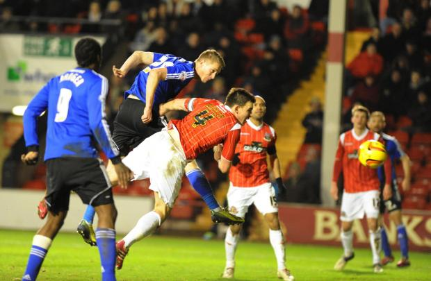 Swindon Town's new signing Michael Smith scores against Walsall last night