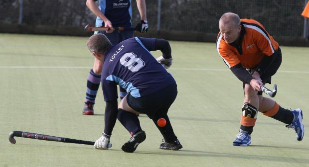 Swindon Advertiser: Mark Tolley, left, in action for Wootton Bassett at the weekend