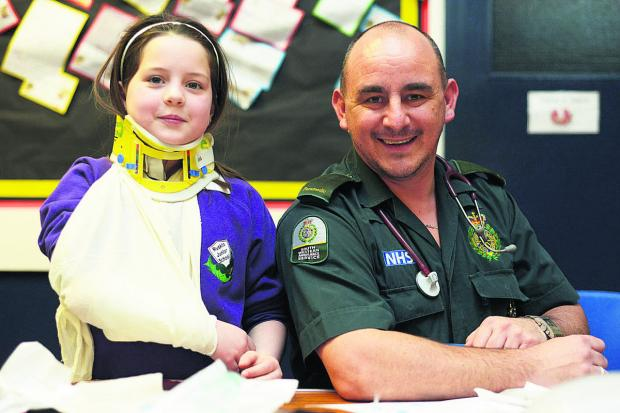 A pupil  from Ruskin Junior School tries out hospital dressings with Steve Tanner