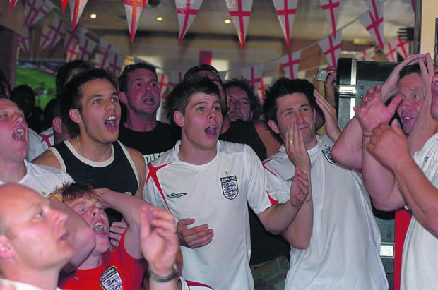 Fans watching an England game at the Dolphin pub in Rodbourne