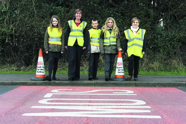 Haydonleigh school have been set aside funds to put a safety zone around the school. Pictured Hattie, Head teacher Frances Billing, Jacob, Eve and Debbie Yockney