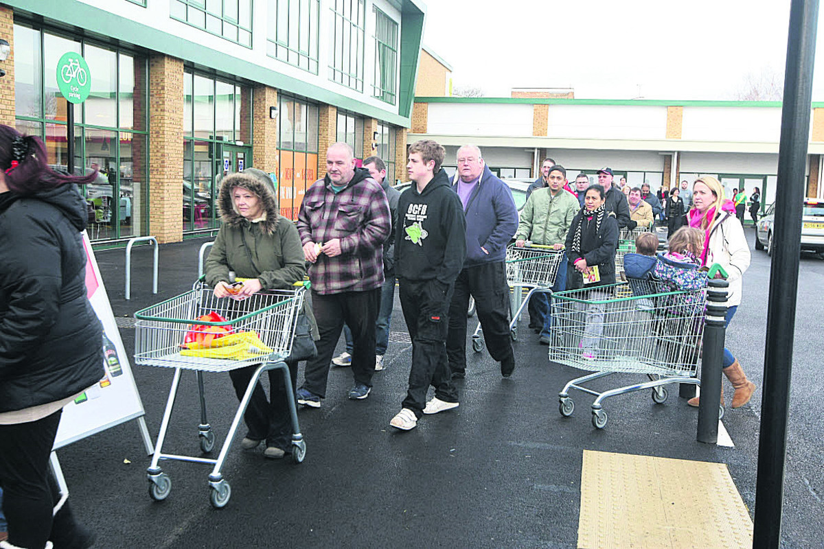 There's a queue of shoppers for the opening of Morrisons' Dorcan Way store in Eldene