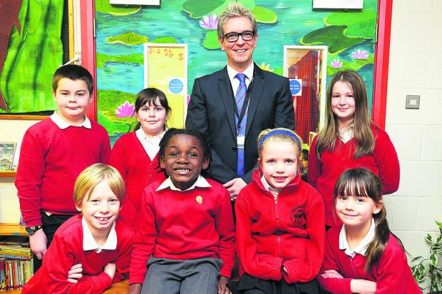 Headteacher  Dan Clarke  with pupils at Brook Field School