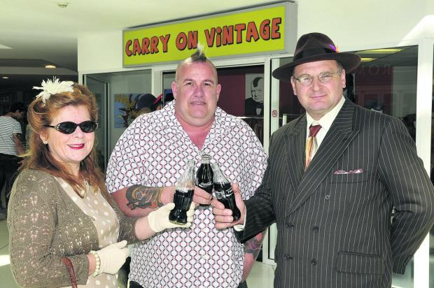 Erica Fowers, Steve Stuart and Cliff Fowers at the opening of Carry On Vintage, which was a pop-up shop in the town
