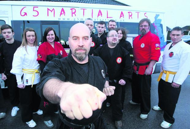 Master instructor Ken Stronach, with members of the G5 Martial arts group