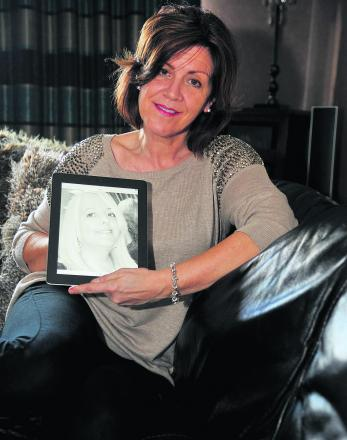 Lynzi Barrett with a picture of her late friend Karen Lloyd