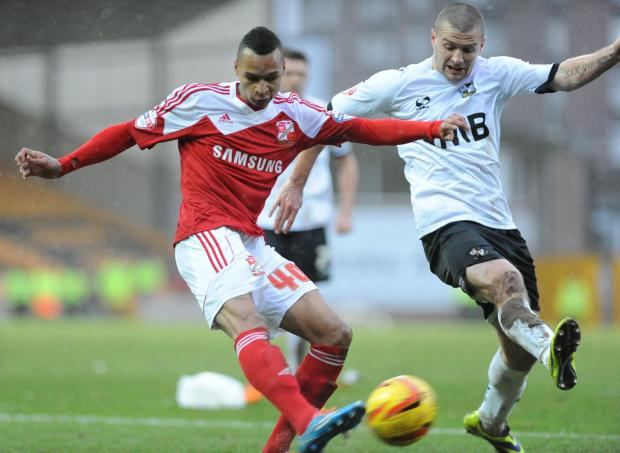 Swindon Advertiser: Loanee Jacob Murphy in action against Port Vale