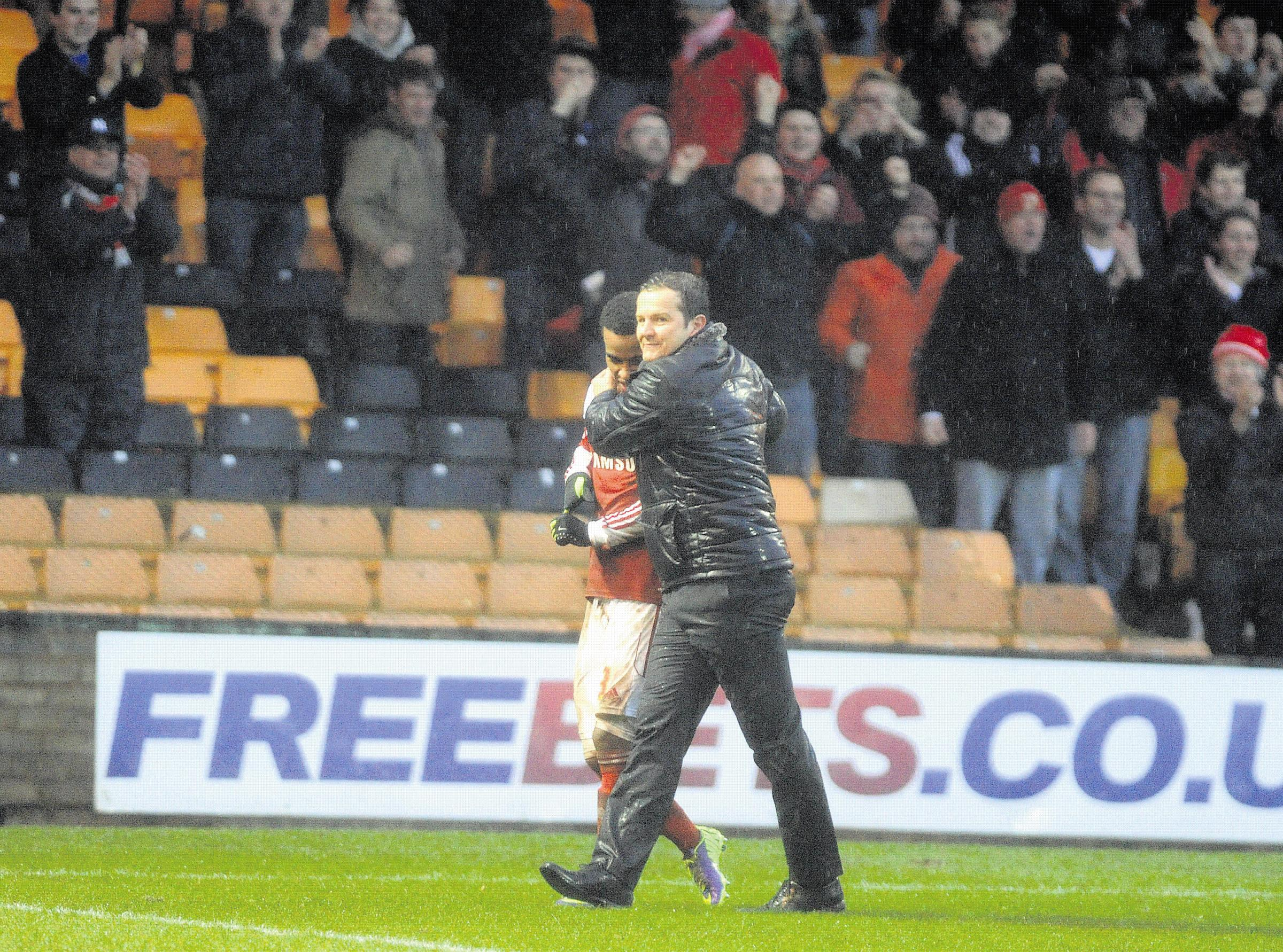 Mark Cooper puts his arm around Nathan Byrne after Town's 3-2 win at Vale Park