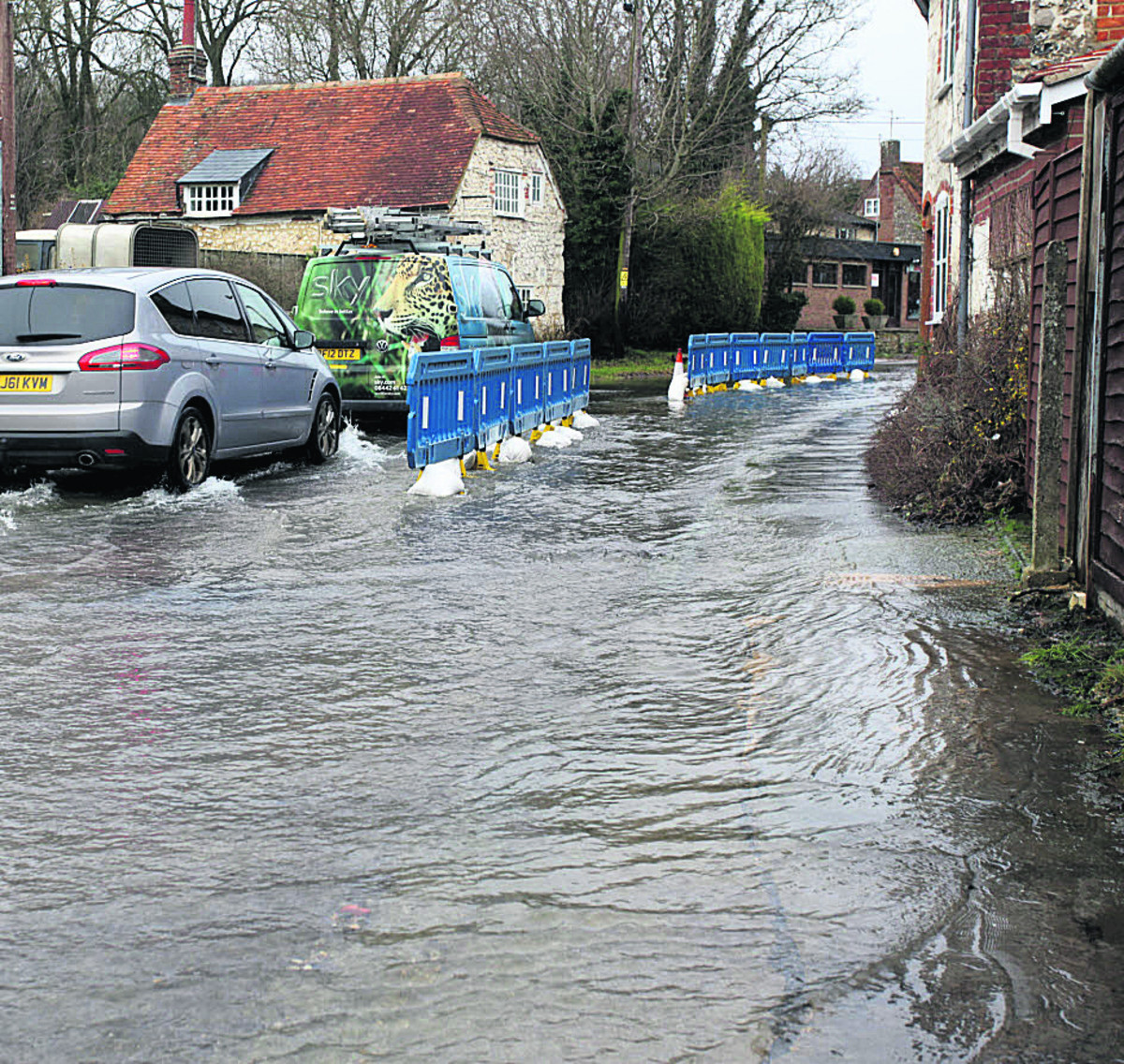 Aldbourne hit by floods after Bradford on Avon defences hold