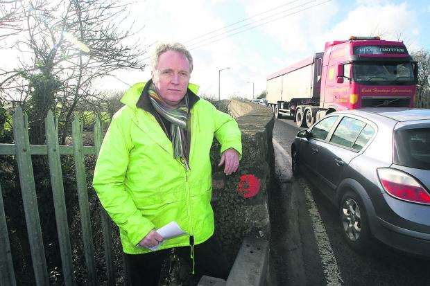 Brian Mathew at the railway bridges between Royal Wootton Bassett and Lyneham which are due to be closed for six months later this year