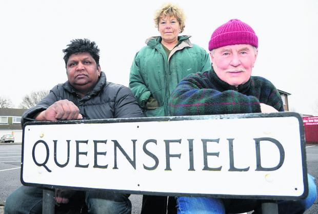 Jeyam Anthony, owner of Queensfield store, left, supported the lifting of the Queensfield traffic ban along with other residents, including Pat Jones and Reg Jones