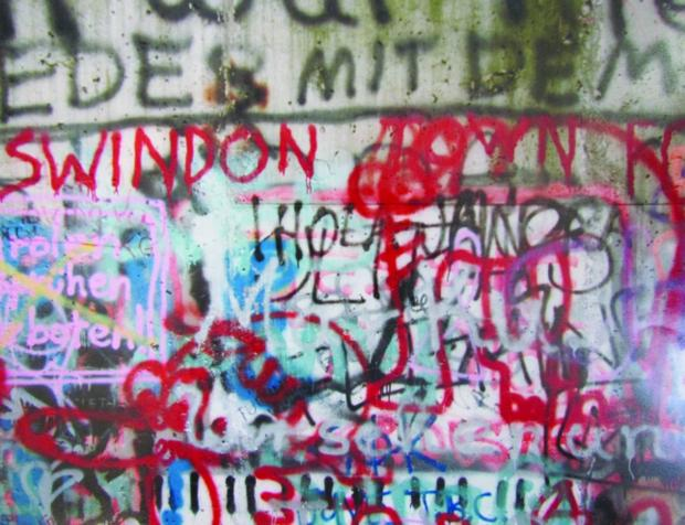 The wall came tumbling down in 1989 ……but not before the immortal slogan 'Swindon Town FC' was added to the spaghetti-like squiggles and graffiti art on the West Berlin side of the partition