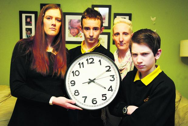 Parents are annoyed that break times at Isambard School have been cut by 15 minutes. Pictured are Amanda Wilkins, James, Wendy Smart and Angelos