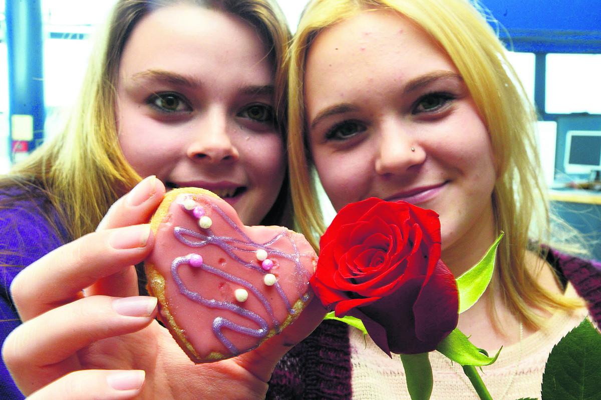 Valentine's cake sale by photography class at New College. Pictured Charli Loso and Jasmin Rennie