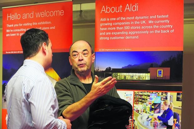 Shaw resident Kevin Hayes talks to Dave Adams of Entran Ltd about the plans for the new Aldi store. Picture: Thomas Kelsey