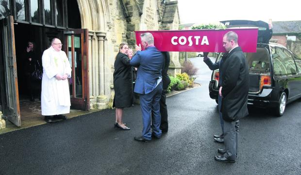 The customised Costa Coffee coffin carrying Karen Lloyd's body arrives at Christ Church