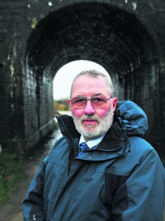 Councillor Wayne Crabbe describes plans to build a tunnel under the M4 for the Wichelstowe  development as mad. He wants a bridge built over the railway