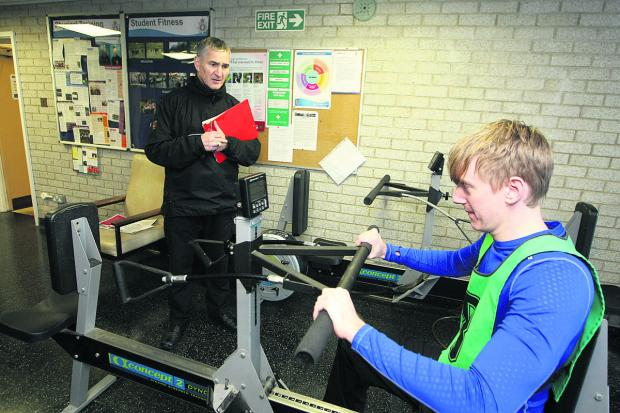 Lead physical training instructor Stuart Dinwoodie watches as Adver deputy news editor Scott D'Arcy has a go at the police fitness test