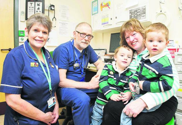 From left, SEQOL nurse Anita Fisher and Bob Sanderson, director of unscheduled care at Carfax Health Enterprise, with Sharon Gerry and her two grandchildren, Eli, two, and Zachery, three