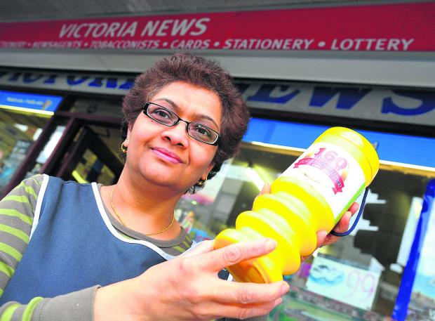 Ilpa Patel of Victoria News in Old Town with one of the collecting tins