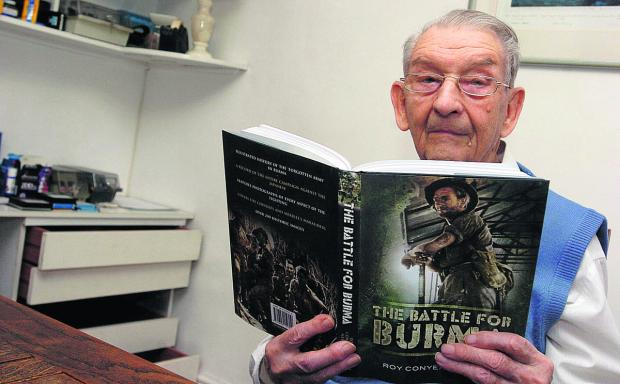 Author Roy Conyers Nesbit  with his book The Battle For Burma