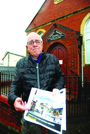 Peter Green outside the damaged chapel